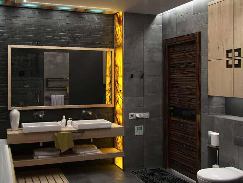 Banheiro todo de mármore na cor cinza.