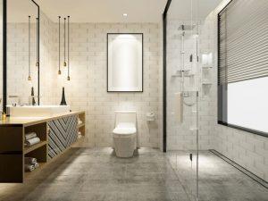 Banheiro com quadro branco e borda preta.