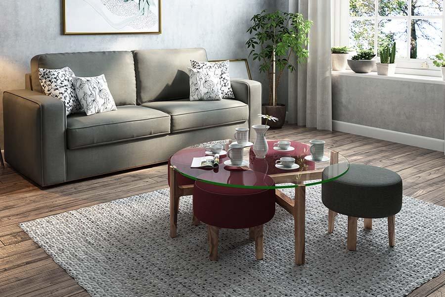 Sala de estar com mesa no centro de vidro com bancos em volta - Como projetar uma sala de estar multiuso